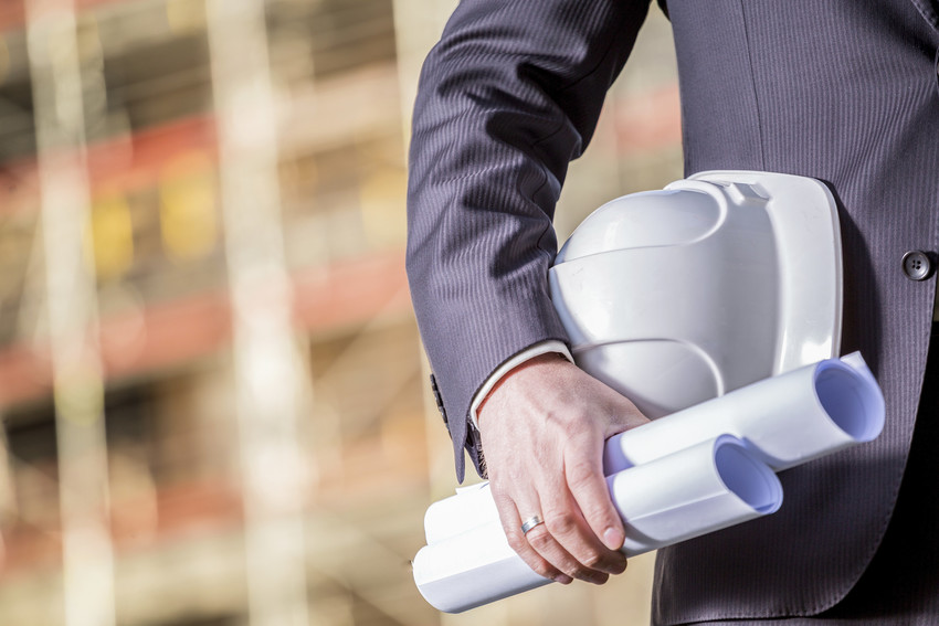 business exec with site plans