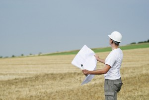 commercial buyer examining land
