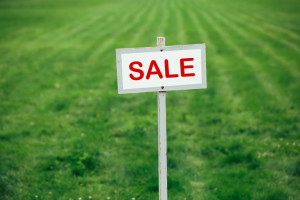 for sale sign on tract of land