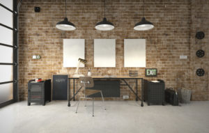 modern corporate office with brick wall creative workspace and canvases on the wall